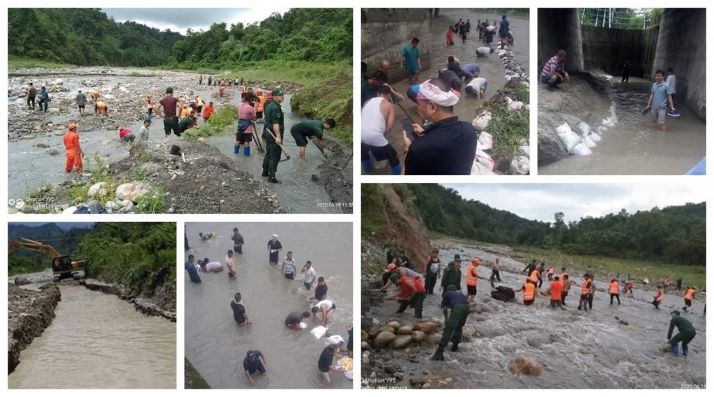 People clearing the natural water blockage